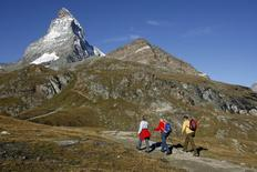 File picture shows hikers walking near the Matterhorn mountain above the village of Zermatt September 10, 2007.   REUTERS/Denis Balibouse/Files