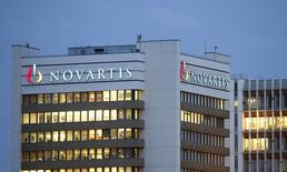 The logo of Swiss drugmaker Novartis is seen at its headquarters in Basel October 22, 2013. Novartis raised its full-year outlook for a second quarter in a row on Tuesday due to the ongoing absence of generic competition to its best-selling blood pressure pill Diovan.   REUTERS/Arnd Wiegmann (SWITZERLAND - Tags: DRUGS SOCIETY BUSINESS LOGO)