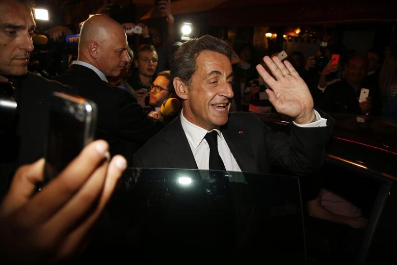 Former French President Nicolas Sarkozy leaves a restaurant in Paris July 2, 2014.  REUTERS/Benoit Tessier