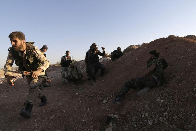 Free Syrian Army fighters are seen together in Wadi Al-Dayf in the southern Idlib countryside July 16, 2014. Picture taken July 16, 2014. REUTERS/Khalil Ashawi