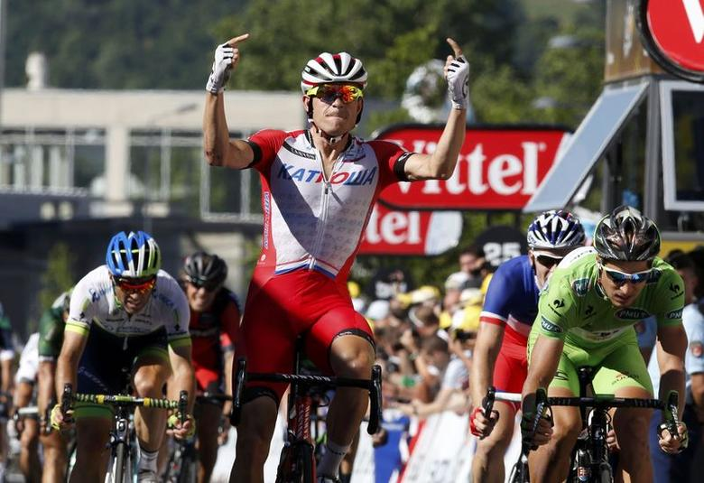 Katusha team rider Alexander Kristoff reacts as he wins the 185.5-km 12th stage of the Tour de France cycling race between Bourg-en-Bresse and Saint-Etienne July 17, 2014.    REUTERS/Jacky Naegelen