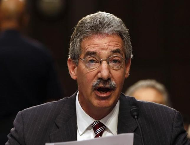 U.S. Deputy Attorney General James Cole answers questions during the Senate Intelligence Committee hearing on the House-passed Foreign Intelligence Surveillance Act reform bill while on Capitol Hill in Washington, June 5, 2014 file photo.  REUTERS/Larry Downing