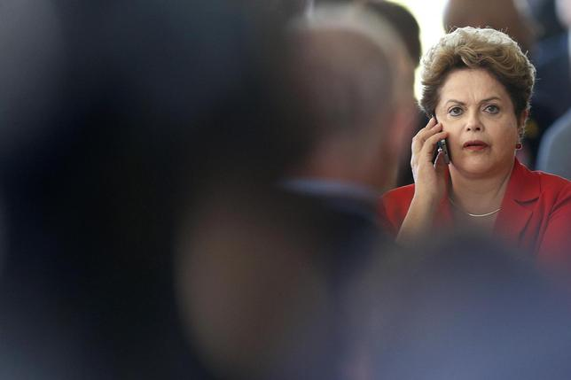 Brazil's President Dilma Rousseff talks on a cell phone during the meeting of China and CELAC at Itamaraty Palace in Brasilia July 17, 2014.  (CELAC). REUTERS/Ueslei Marcelino
