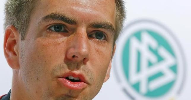 Germany's national soccer team player Philipp Lahm addresses a news conference in the village of Santo Andre north of Porto Seguro July 11, 2014. REUTERS/Arnd Wiegmann
