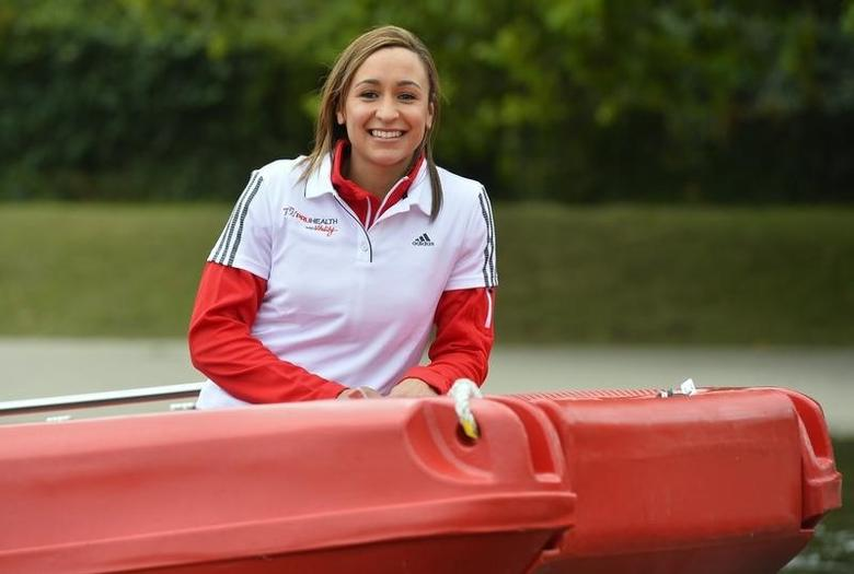 British Olympic champion heptathlete Jessica Ennis-Hill arrives in a boat at the Serpentine lake at Hyde Park in London September 11, 2013. REUTERS/Toby Melville