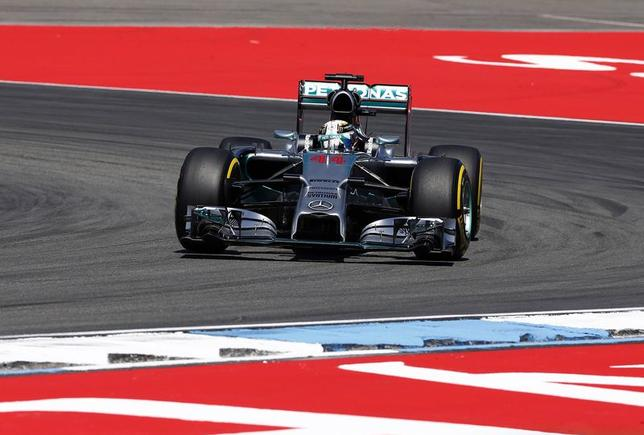 Mercedes Formula One driver Lewis Hamilton from Great Britain speeds during the second free practice of the German F1 Grand Prix at the Hockenheim racing circuit, July 18, 2014. REUTERS/Michael Dalder