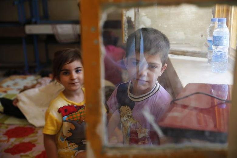 Children of a Christian family, who fled from the violence in Mosul stay at a school in Arbil, in Iraq's Kurdistan region June 27, 2014. REUTERS/Ahmed Jadallah
