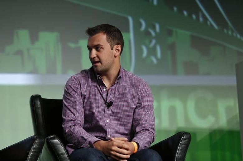 John Zimmer, co-founder ride-sharing star up Lyft, speaks on stage during day one of TechCrunch Disrupt SF 2012 event at the San Francisco Design Center Concourse in San Francisco, California September 10, 2012. REUTERS/Stephen Lam