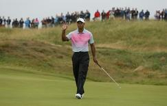 Tiger Woods of the U.S. gestures after making a birdie putt on the 11th green during the third round of the British Open Championship at the Royal Liverpool Golf Club in Hoylake, northern England July 19, 2014.     REUTERS/Stefan Wermuth