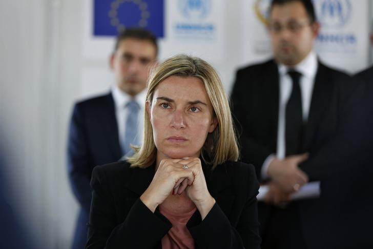 Italian Foreign Minister Federica Mogherini, listens to Andrew Harper, UNHCR representative to Jordan, during her visit to Azraq refugee camp near Al Azraq, east of Amman, June 8, 2014. REUTERS/Muhammad Hamed