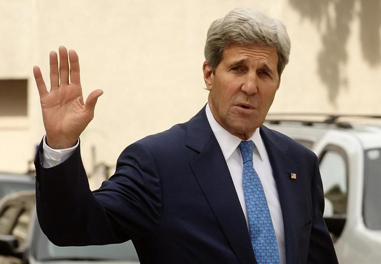 U.S. Secretary of State John Kerry waves to journalists as he walks to a meeting on the second straight day of talks over Tehran's nuclear program at a hotel in Vienna July 14, 2014.  REUTERS/Heinz-Peter Bader