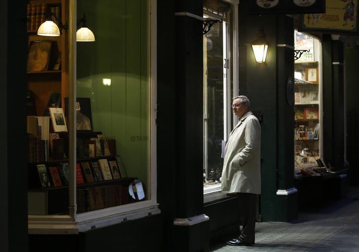 A man looks into the window of a shop in London January 17, 2014.  REUTERS/Luke MacGregor