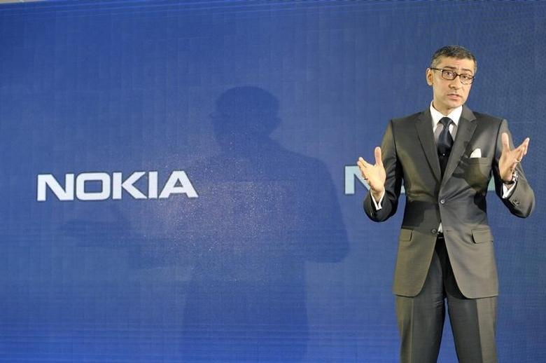 Nokia CEO Rajeev Suri speaks during a news conference to announce its first quarter earnings in Espoo April 29, 2014  REUTERS/Heikki Saukkomaa/Lehtikuva
