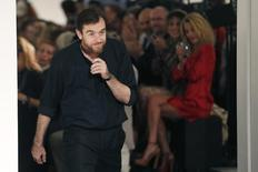 French designer Christophe Lemaire appears at the end of his Spring/Summer 2013 women's ready-to-wear fashion show for fashion house Hermes during Paris fashion week September 30, 2012.     REUTERS/Charles Platiau