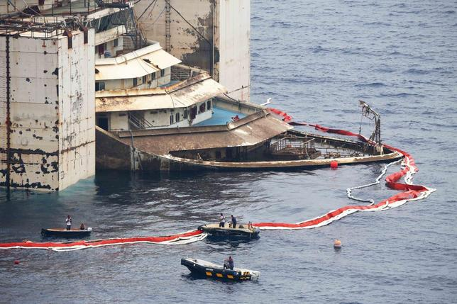 The bow of the Costa Concordia cruise liner is seen as it emerges during the refloating operation at Giglio harbour July 20, 2014. . REUTERS/Alessandro Bianchi
