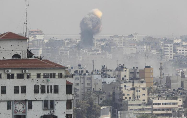 Flames and smoke are seen following what witnesses said was an Israeli air strike, in Gaza City July 21, 2014.REUTERS/Ahmed Zakot