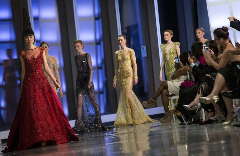 Models present creations during the J Summer Fashion Show at One World Trade Center in New York June 25, 2014. Picture taken June 25, 2014. REUTERS/Brendan McDermid