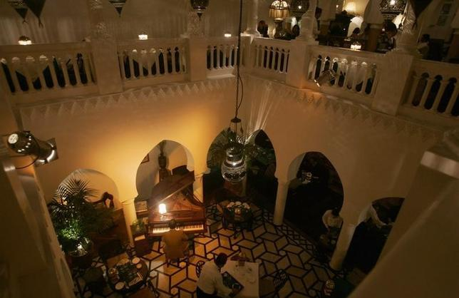 Pianist Issam plays at Rick's Cafe in Casablanca in this picture taken February 27, 2008. REUTERS/Rafael Marchante