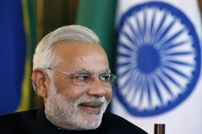 India's Prime Minister Narendra Modi reacts during a meeting with Brazil's President Dilma Rousseff (not pictured) on the sidelines of the 6th BRICS summit at the Alvorada Palace in Brasilia July 16, 2014. REUTERS/Ueslei Marcelino