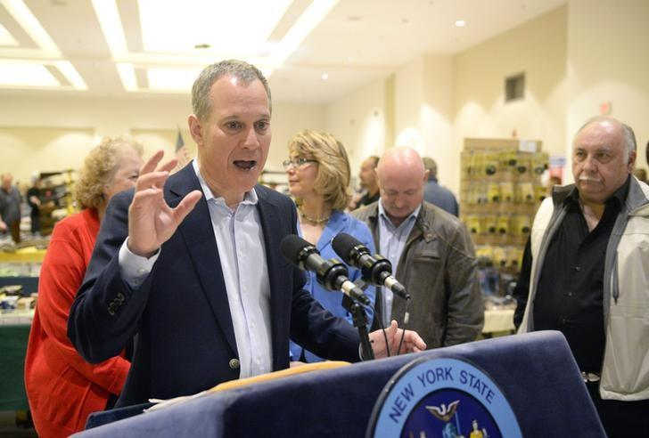 New York Attorney General Eric Schneiderman speaks to reporters during the New Eastcoast Arms Collectors Associates Arms Fair at the Saratoga Springs City Center in Saratoga Springs, New York October 13, 2013 file photo. REUTERS/Hans Pennink
