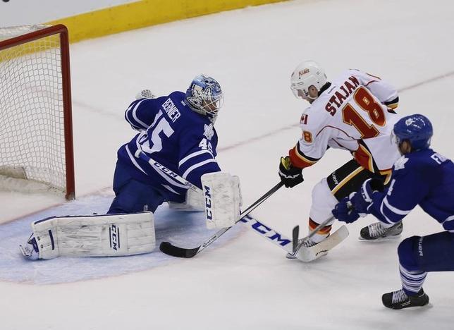 Calgary Flames forward Matt Stajan (18) scores on Toronto Maple Leafs goaltender Jonathan Bernier (45) as defenseman Cody Franson (4) defends during the second period at the Air Canada Centre. Apr 1, 2014; Toronto, Ontario, CAN; USA TODAY Sports -