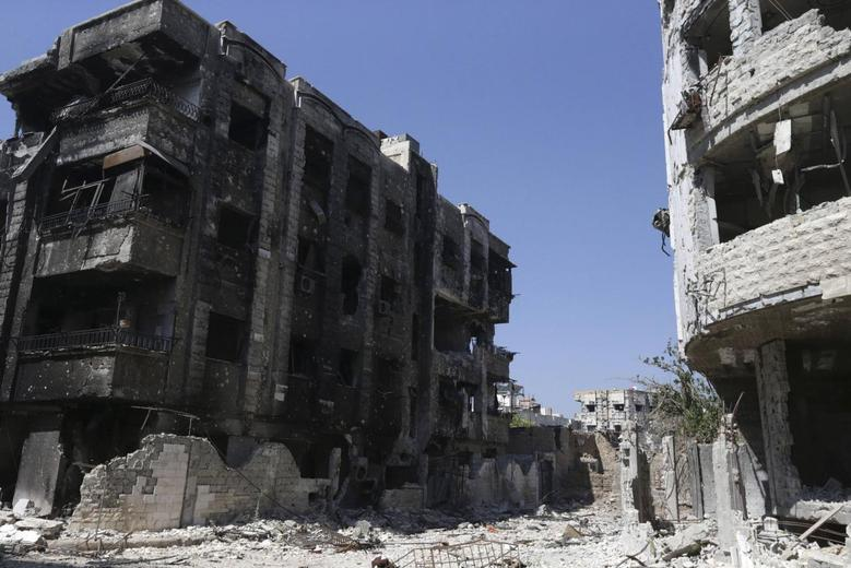 A general view shows damaged buildings in Jobar, a suburb of Damascus July 18, 2014. REUTERS/Bassam Khabieh