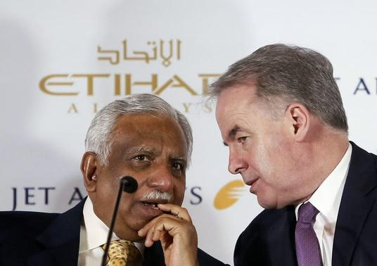 Naresh Goyal (L), chairman of Jet Airways, speaks with James Hogan, chief executive of Abu Dhabi's Etihad Airways, during a news conference in New Delhi July 23, 2014. REUTERS/Anindito Mukherjee