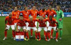 Netherlands national soccer players pose for a team photo before their 2014 World Cup semi-finals against Argentina at the Corinthians arena in Sao Paulo July 9, 2014.                REUTERS/Michael Dalder
