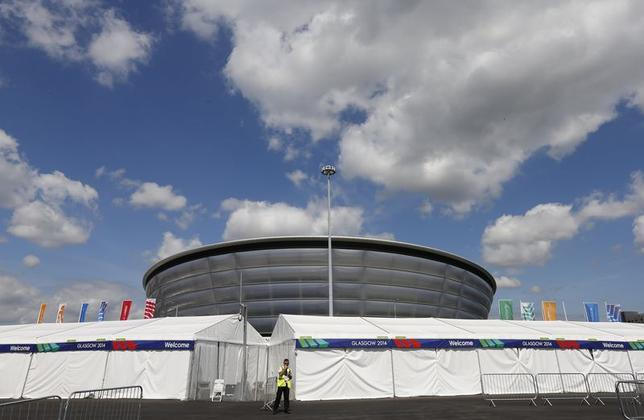 A guard stands outside the security perimeter of the SSE Hydro in Glasgow, Scotland, July 22, 2014. REUTERS/Suzanne Plunkett