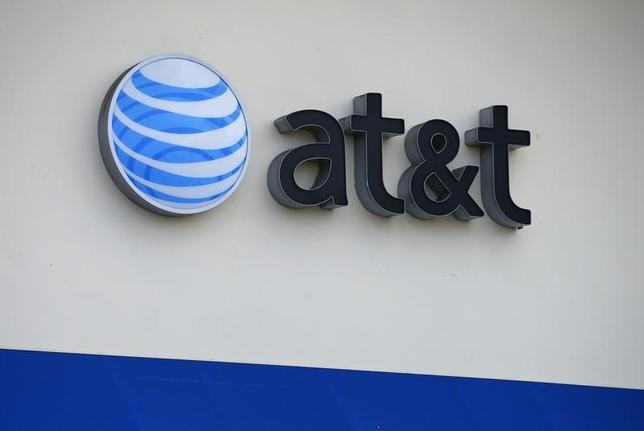 The AT&T logo is pictured by its store in Carlsbad, California, April 22, 2013.  REUTERS/Mike Blake /Files