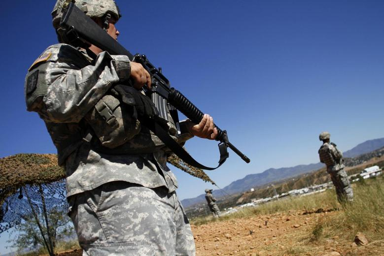 United States National Guard troops patrol along the U.S. and Mexico border in Nogales, Arizona in this file photo from October 8, 2010.  REUTERS/Joshua Lott/Files