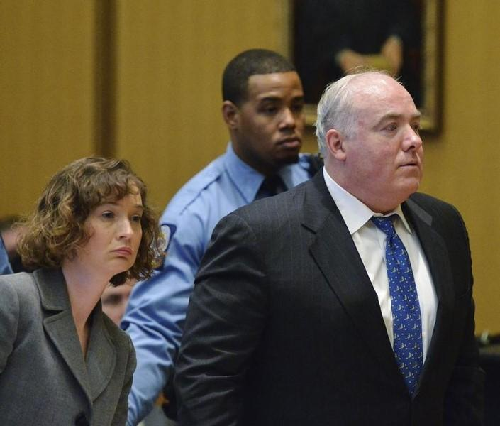Michael Skakel (R) and his defense attorney Jessica Santos reacts to being granted bail during his hearing at Stamford Superior Court, in Stamford, Connecticut November 21, 2013.   REUTERS/Bob Luckey/Pool