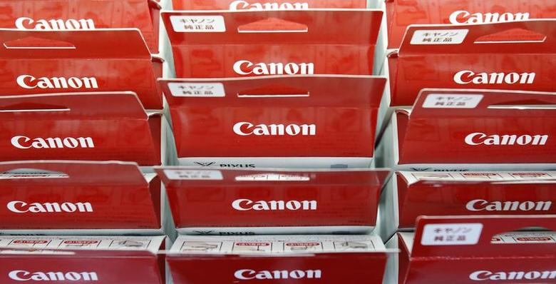 Canon's logos are pictured on printer ink packages displayed at an electronics retail store in Tokyo July 24, 2014.  REUTERS/Yuya Shino