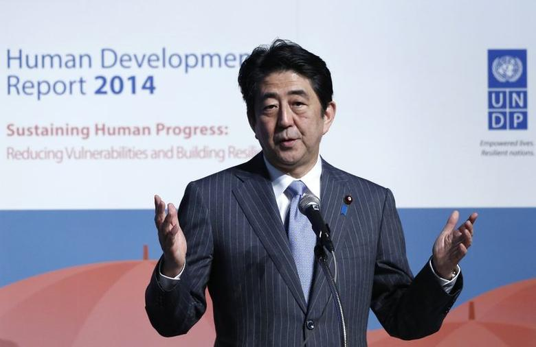 Japan's Prime Minister Shinzo Abe gives a speech during an announcement event of the Global Launch of Human Development Report 2014 at the United Nations University Headquarters in Tokyo July 24, 2014. REUTERS/Yuya Shino