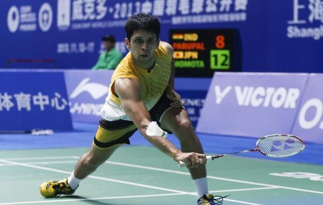 India's Kashyap Parupalli hits a return to Japan's Kento Momota during their men's singles match at the second round of the China Open Badminton Tournament in Shanghai, November 14, 2013. REUTERS/Stringer/Files