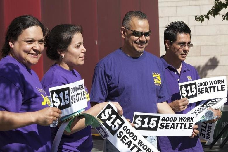 Labor activists celebrate during a rally at Seattle City Hall after a Seattle City Council meeting in which the council voted on raising the minimum wage to $15.00 per hour in Seattle, Washington June 2, 2014.    REUTERS/David Ryder