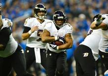 Baltimore Ravens running back Ray Rice (27) runs the ball during the second quarter against the Detroit Lions at Ford Field. Dec 16, 2013; Detroit, MI, USA; Andrew Weber-USA TODAY Sports -