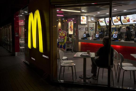 A customer is seen through the windows of a McDonald's store in Hong Kong July 25, 2014. REUTERS/Tyrone Siu
