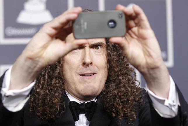 Singer Weird Al Yankovic arrives at the 54th annual Grammy Awards in Los Angeles, California February 12, 2012. REUTERS/Danny Moloshok/Files