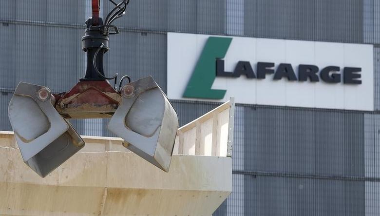 A logo is seen at a Lafarge concrete production plant in Pantin, outside Paris, April 7, 2014.  REUTERS/Christian Hartmann