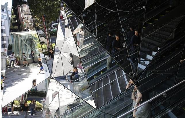 People are reflected in mirrors at an entrance of a shopping complex in Tokyo September 27, 2013. REUTERS/Toru Hanai