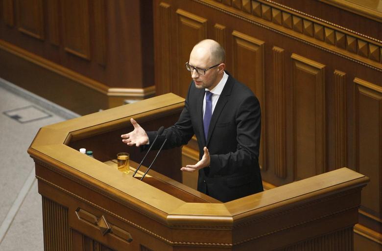 Ukrainian Prime Minister Arseny Yatseniuk addresses parliament in Kiev July 24, 2014. REUTERS/Alex Kuzmin