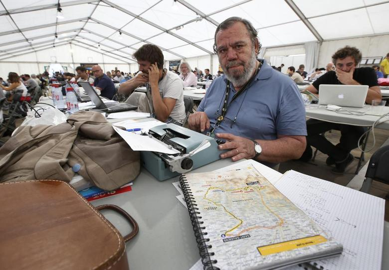 Gianni Mura, a 68-year-old Italian journalist, poses with his typewriter after an interview with Reuters during the 124.5km seventeenth stage of the Tour de France cycle race between Saint-Gaudens and Saint-Lary Pla d'Adet, July 23, 2014.  REUTERS/Jacky Naegelen