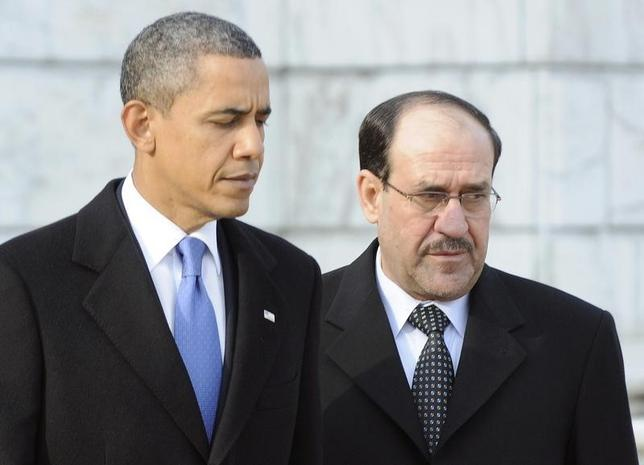 U.S. President Barack Obama (L) and Iraq's Prime Minister Nuri al-Maliki arrive to lay a wreath at the Tomb of the Unknowns at Arlington National Cemetery in Arlington, Virginia, December 12, 2011. Picture taken December 12, 2011.  REUTERS/Jonathan Ernst