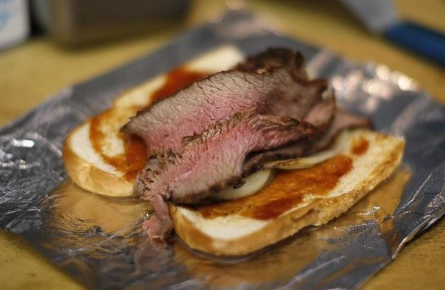 Slices of beef are seen on a sandwich at The Outdoor Grill in Culver City, Los Angeles, California April 10, 2014. Retail beef and pork prices reached all-time highs last month, according to Bill Hahn, agricultural economist at the U.S. Department of Agriculture's Economic Research Service. REUTERS/Lucy Nicholson