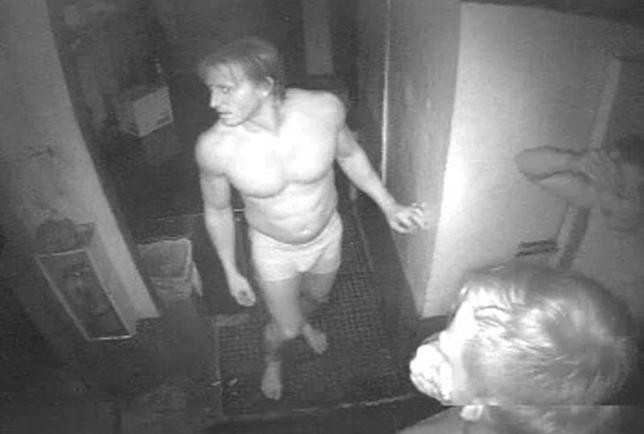 A group of three men wearing only underwear are seen in the kitchen of Doc's Beach House restaurant in Bonita Springs, Florida in this July 20, 2014, handout photo taken from security camera video released by the Lee County Sheriff's Office. REUTERS/Lee County Sheriff's Office/Handout