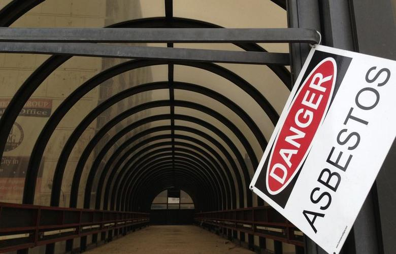 A warning sign is seen on a walkway leading to the abandoned Sheraton Hotel in downtown Gary, Indiana in this August 28, 2013  file photo. REUTERS/Jim Young/Files
