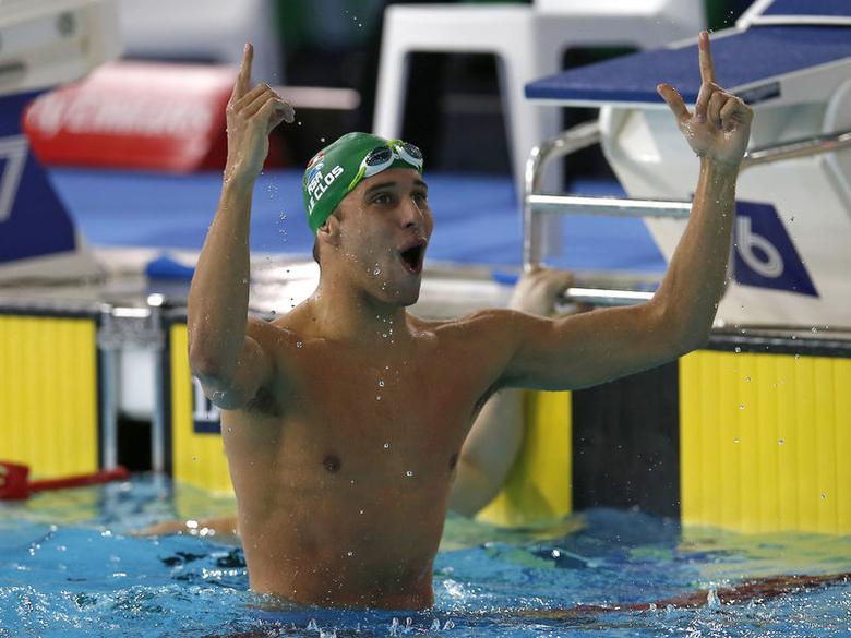 South Africa's Chad le Clos celebrates winning in the men's 200m Butterfly final at the Commonwealth Games in Glasgow, Scotland, July 26, 2014. REUTERS/Jim Young