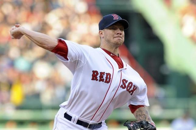 May 29, 2014; Boston, MA, USA; Boston Red Sox starting pitcher Jake Peavy (44) pitches during the first inning against the Atlanta Braves at Fenway Park. Mandatory Credit: Bob DeChiara-USA TODAY Sports