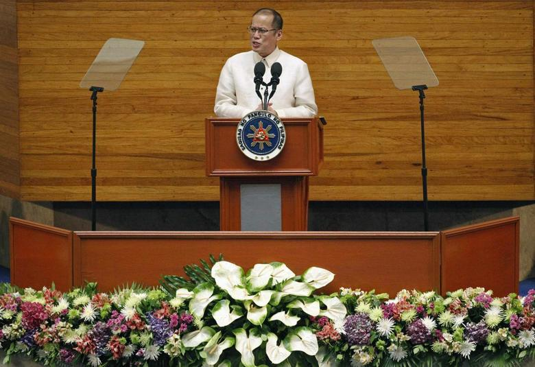 Philippine President Benigno Aquino delivers his fifth State of the Nation Address (SONA) during the joint session of the 16th Congress at the House of Representatives of the Philippines in Quezon city, metro Manila July 28, 2014. REUTERS/Romeo Ranoco